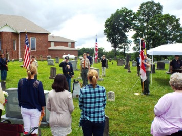Saluting the grave of Private Cupp