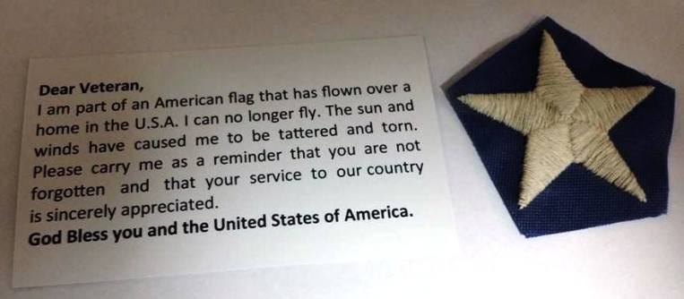 card-and-piece-of-flag-given-to-veterans-at-fort-dickerson